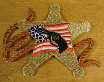 "Strijkapplicaties  "" Ster, pistool, amerikaanse vlag "" Links"