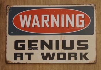 "Billboard "" Warning genius at work """