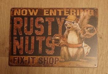 """Billboard """" Now entering rusty nuts fix it shop """""""