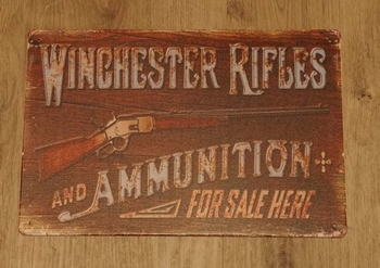 """Billboard  """" Winchester rifles and ammuntion fore sale here"""