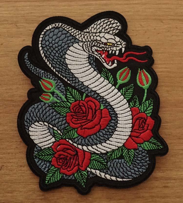 """Applicatie   """" Cobra met rozen """""""