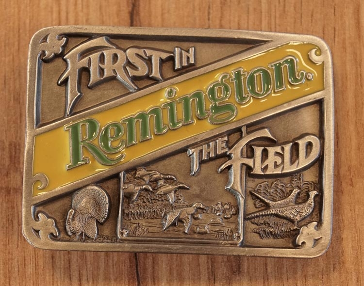 "Belt buckle  "" First in Remington, the field """