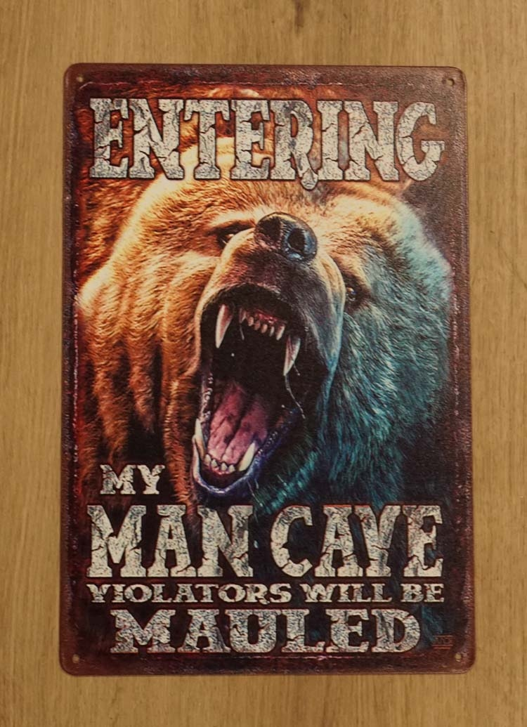 "Billboard  "" Entering my man cave violators will be mauled """
