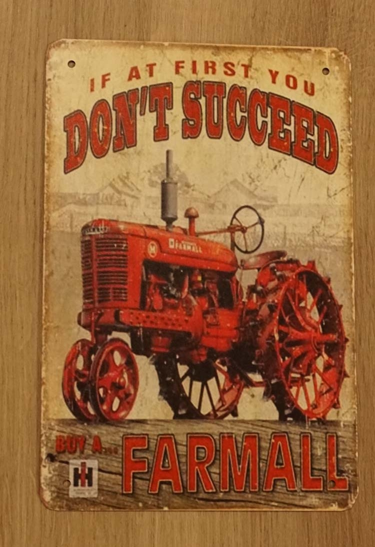 "Billboard  "" If at first you don't succeed buy a farmall """