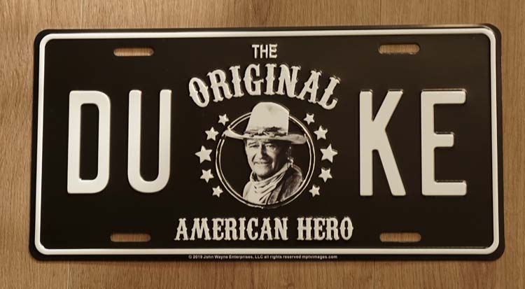"Billboard  "" The original duke American hero "" John Wayne"