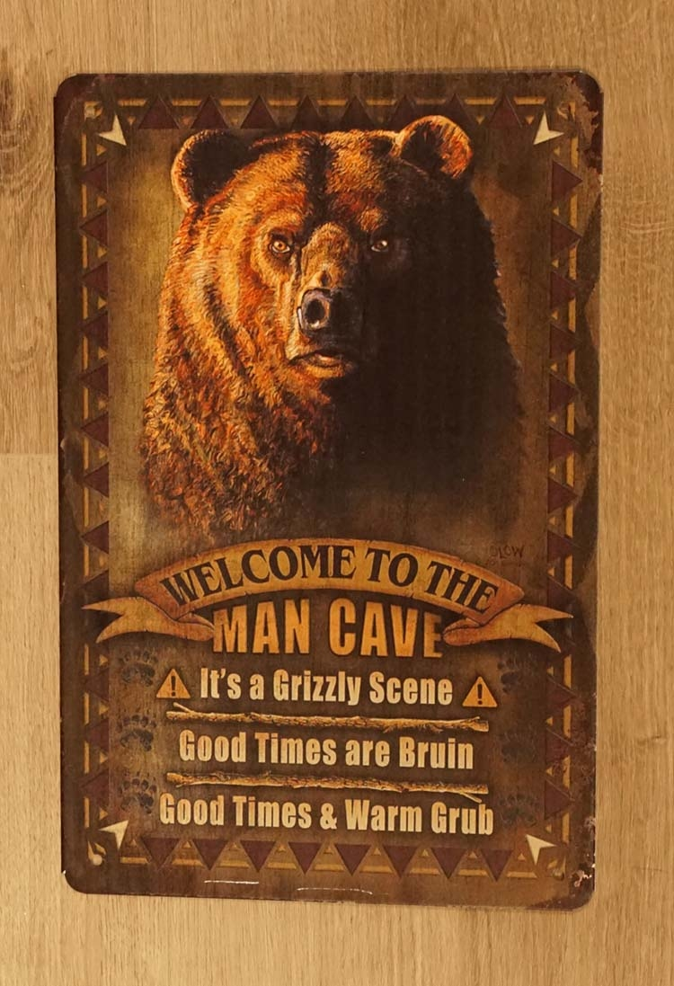 "Billboard  "" Welcome to the man cave ""  Grizzly beer"