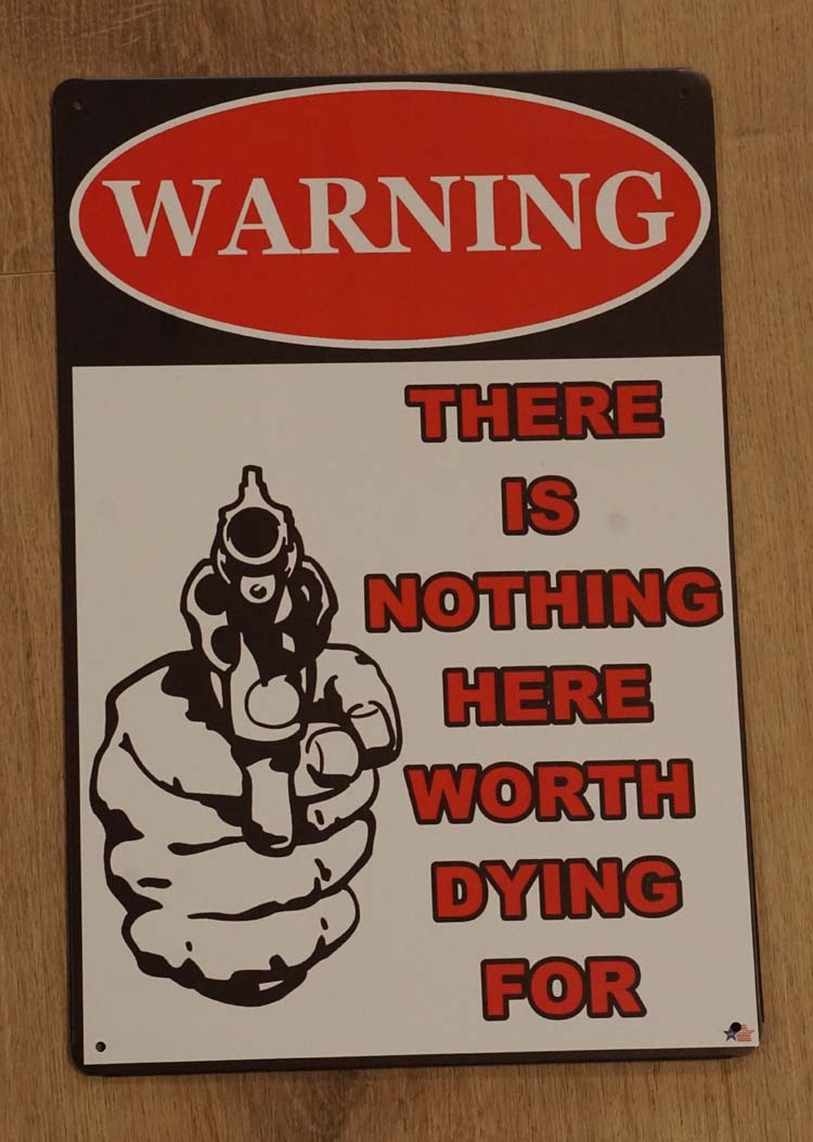 """Billboard """" Waring There is nothing here worth dying for """""""