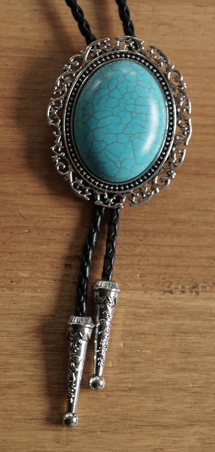 "Bolo tie  "" Turquoise steen met sierrand ""  UITVERKOCHT"