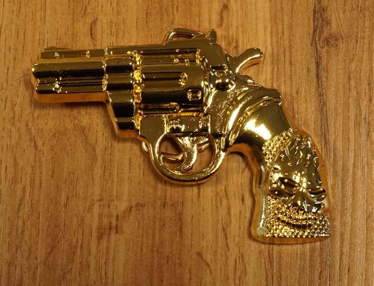 """Buckle  """" Revolver handvat doodskop """"  goudkleurig"""